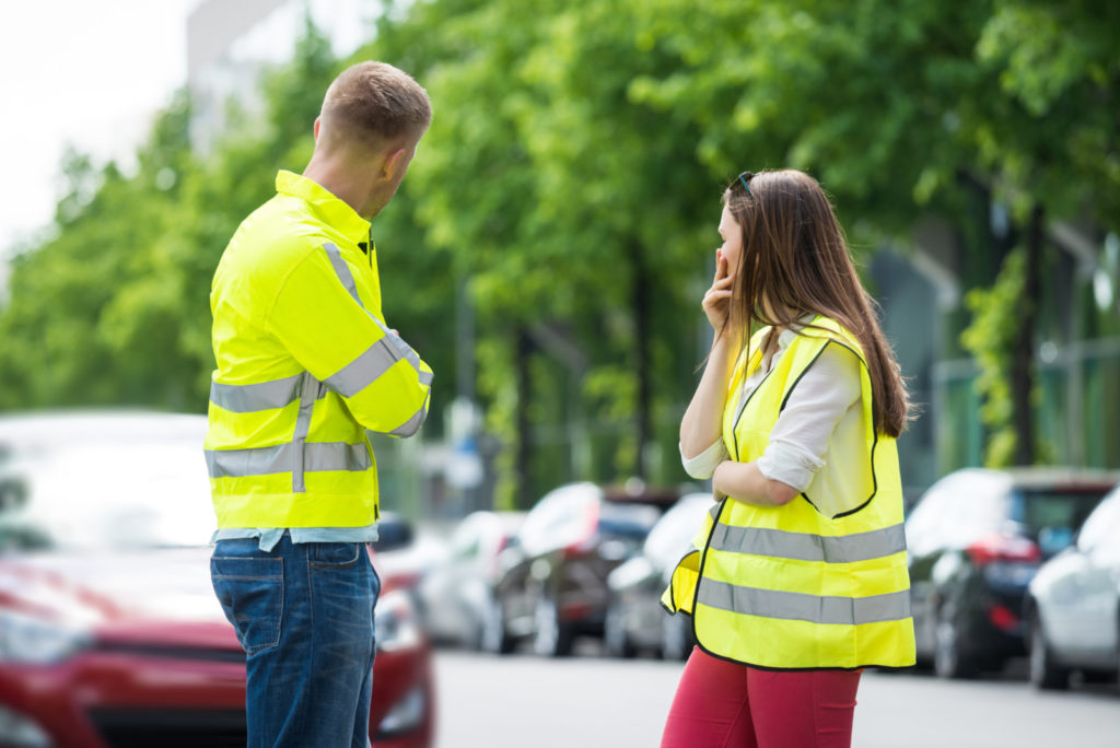 Young couple in yellow vests